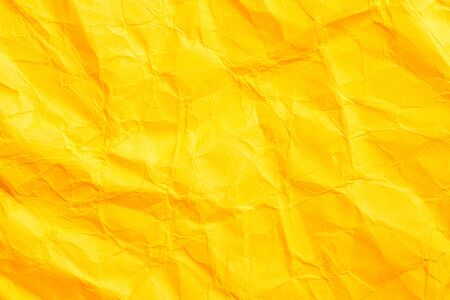 Abstract crumpled orange color paper texture. thick crumpled cardboard