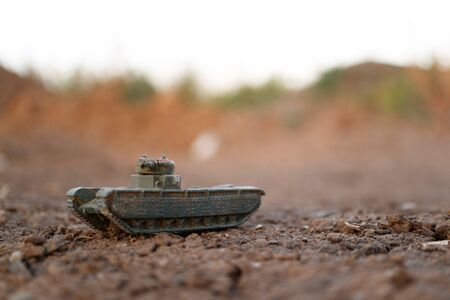 toy tank green clay brown earth, the dawn of time