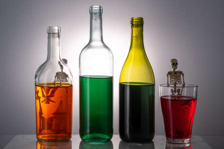 bottles of alcohol of different colors for bottles of skeletons. alcohol harm concept