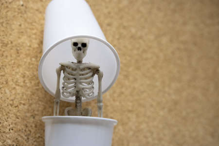 the skeleton was hidden in a plastic container. hidden threat in plastic for the world 版權商用圖片