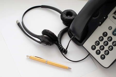 fountain pen and headset at the push-button telephone, the workplace of the employee who is engaged in informing by telephone