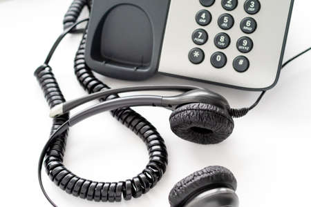 headset wired to a push-button telephone. employee workstation for calling clients