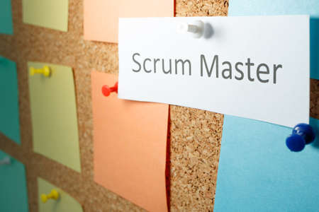 Scrum is written on a sheet of paper attached to a blackboard. perspective outgoing plan