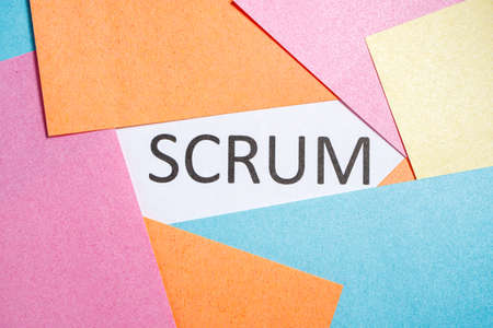 Scrum inscription on white paper around which are colored sheets 版權商用圖片