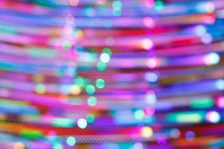 abstract background of horizontally glowing objects out of focus. festive lighting