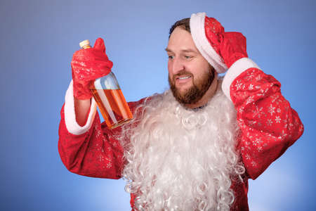 a man holds a long-awaited bottle of alcohol in his hands and rejoices. drink for the holiday