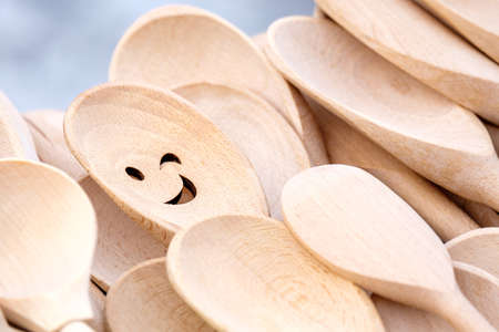 wooden kitchen spoons one of them with a smile. sale of spoons