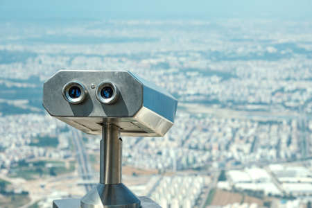 stationary paid binoculars on a mountain in Turkey in Antalya. city view steel frame