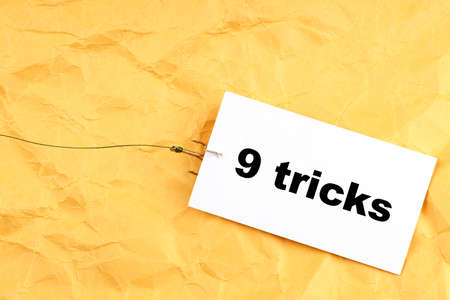 fishhook paper with 9 tricks written on it. tricks for people