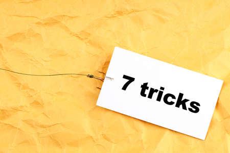 fishhook paper with 7 Tricks written on it. tricks for people