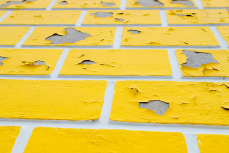 wall with peeling yellow paint, poorly painted wall Stock fotó