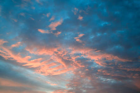 sky with clouds during sunset, blue and orange color. beautiful evening sky