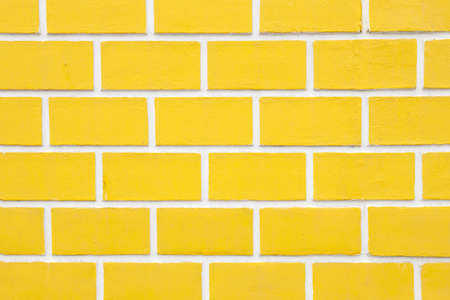 yellow painted brick wall, large brick. decorative wall