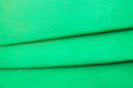 the background of the green surface waves downward. steps on a green background Stock fotó