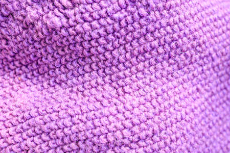 purple knitted item with waves, close-up of knitted details Stock fotó