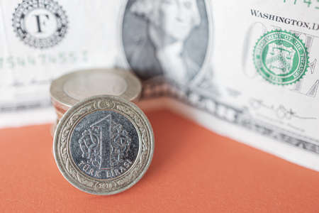 modern lira coin on dollar background. the concept of confrontation and cooperation of the economies of the us and turkey