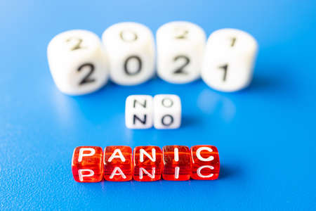 no panic is the word cubes, blurred date 2021 in the background. a year without panic Foto de archivo