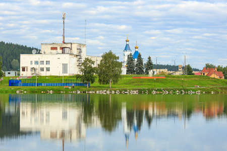 Verkhniye Sergi, Russia - September. 06 2020 a large building reflecting in the water on the opposite side of the pond