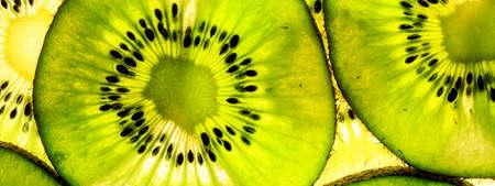 close-up of sliced kiwi fruit, banner with kiwi