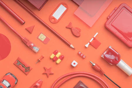 top view of red objects on a red background. ordinary objects that everyone has in the house 免版税图像