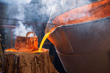 the process of pouring molten metal into a mold, smoke and heat in the workshop