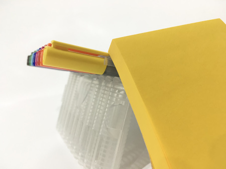 summarize: Colorful magic pen with post it use for summarizing and easily remember in yello theme on white background