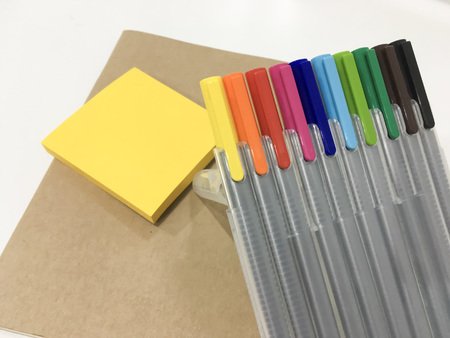 colorful magic pen with notebook ad post it use for summarizing and easily remember on white background