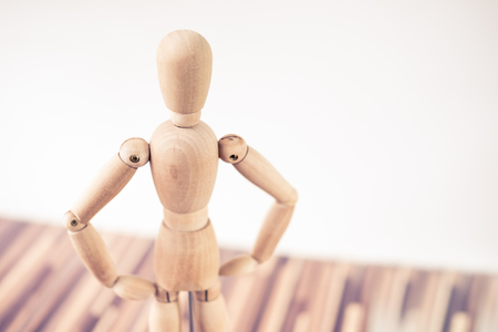 humble: timber figure standing confidently Stock Photo