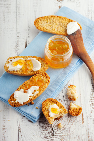 morning breakfast: Morning breakfast with crackers and orange marmalade on white wooden table
