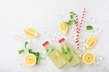 Fresh homemade summer  lemonade or mojito cocktail with lemon and mint. Cold refreshing drink or beverage with ice on white background, top view 스톡 콘텐츠 - 125483004