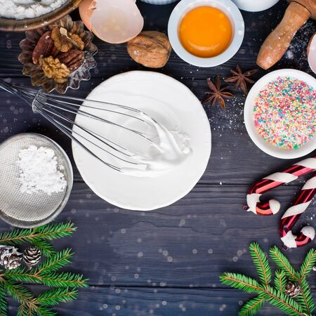 Baking ingredients for winter homemade Holiday Christmas pastry on dark rustic wooden background. Bake sweet cake dessert concept. Top view, flat lay style Stok Fotoğraf