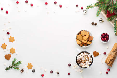 Rustic white wooden background with cup of hot chocolate drink and Christmas cookies. Seasonal background from above. Flat lay, top view. Holiday card mockup, copy space Zdjęcie Seryjne