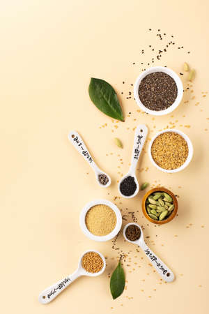 Healthy food clean eating concept. Assortment seeds, superfood on beige paper background. Set of sesame, flax seed, chia, hemp seeds, amaranth. Top view, copy space. 스톡 콘텐츠