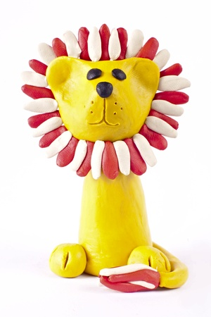 Plasticine lion isolated over white