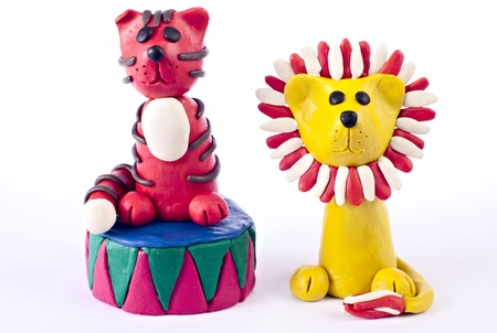 child's play clay: Plasticine lion and tiger from circus playing