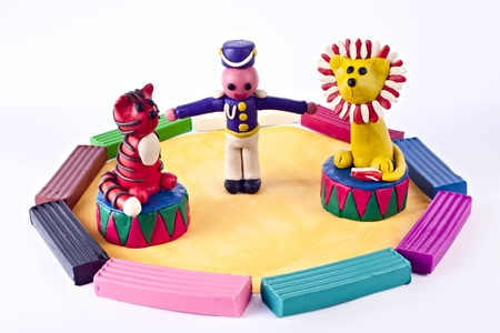 Plasticine circus. Animal trainer with tiger and lion photo