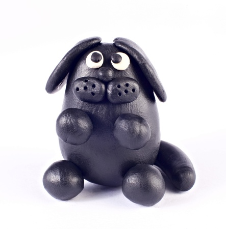 child's play clay: Plasticine dog isolated over white