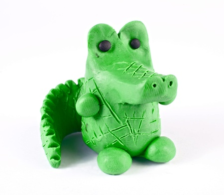 child's play clay: Plasticine crocodile isolated over white