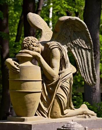 grieving: Statue of weeping angel, necropolis of Donskoy monastery, Moscow Stock Photo