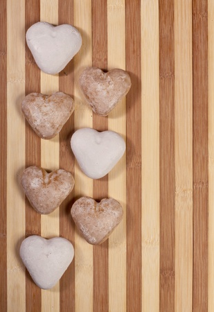 Valentine background with cookies on a wooden surface photo