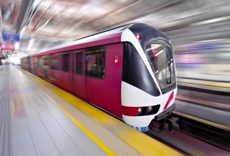 Fast LRT train in motion, Kuala Lumpur, Malaysia photo