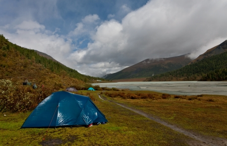 Wet tent at the river bank, Altai mountains photo