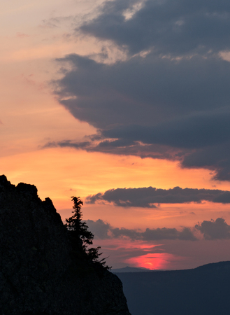 cloudscape: Sunset with silhouette and cloudscape