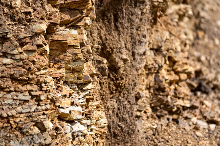 gully: Background with cracked stones in ravine wall