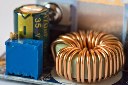 electrolytic: Inductance coil on circuit board Stock Photo