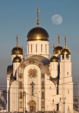 Orthodox cathedral with golden domes and full moon