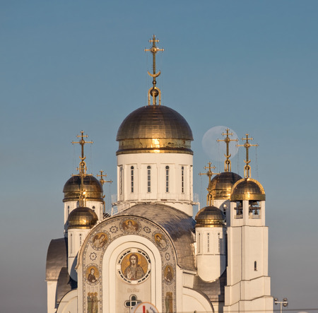 Orthodox cathedral with golden domes and full moon behind Stock Photo