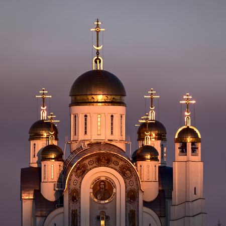 Orthodox cathedral with golden domes with sunset illumination. Cathedral of Jesus Ascention im Magnitogorsk; Russia Stock Photo