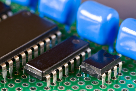 Integral circuits and capacitors on Printed Circuit Board