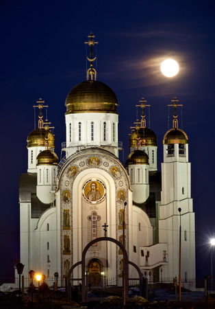 Orthodox cathedral in Magnitogorsk and full moon behind